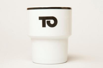A mug with a TO [THIS] logo
