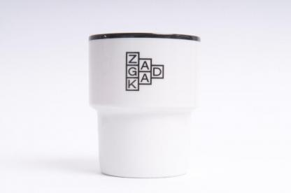 A mug with a ZAGADKA [RIDDLE] logo